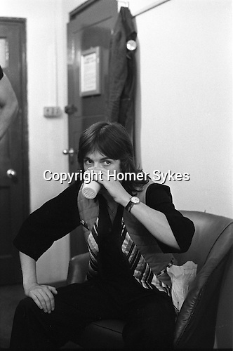 "Jimmy McCulloch Paul and Linda McCartney Wings Tour 1975.Green Room Liverpool. The photographs from this set were taken in 1975. I was on tour with them for a children's ""Fact Book"". This book was called, The Facts about a Pop Group Featuring Wings. Introduced by Paul McCartney, published by G.Whizzard. They had recently recorded albums, Wildlife, Red Rose Speedway, Band on the Run and Venus and Mars. I believe it was the English leg of Wings Over the World tour. But as I recall they were promoting,  Band on the Run and Venus and Mars in particular."
