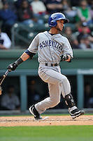 Infielder Carlos Herrera (4) of the Asheville Tourists bats in a game against the Greenville Drive on Sunday, April 10, 2016, at Fluor Field at the West End in Greenville, South Carolina. Greenville won, 7-4. (Tom Priddy/Four Seam Images)