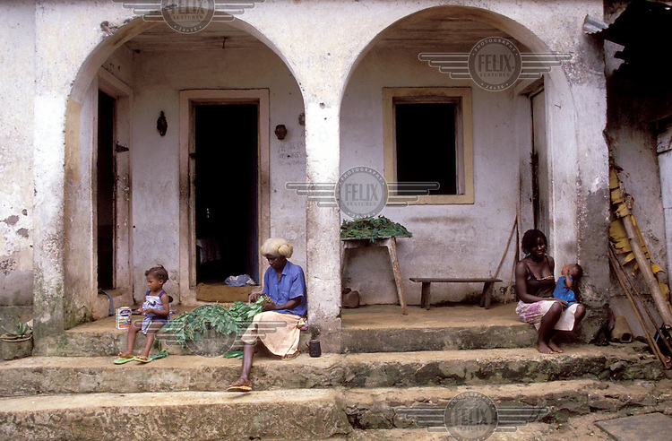 © Giacomo Pirozzi / Panos Pictures..SAO TOME..Extended family living in an old colonial-era building.