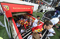 20191221 - LENS , FRANCE : players of both teams entering the pitch pictured during the soccer match between Racing Club de LENS and Niort , on the 19 th matchday in the French Ligue 2 at the Stade Bollaert Delelis stadium , Lens . Saturday 21 December 2019. PHOTO DIRK VUYLSTEKE   SPORTPIX.BE