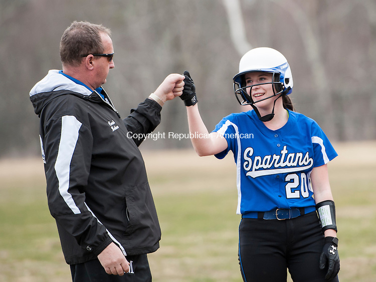 LITCHFIELD, CT-14 April 2015-041415EC16-  Lewis Mills' Emma Kryzanski hits a triple against Litchfield Tuesday and gets congratulations from coach David Bohmer at third base. Erin Covey Republican-American