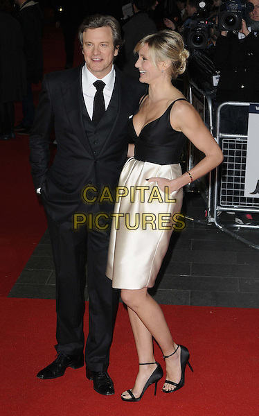 Colin Firth & Cameron Diaz.'Gambit' world film premiere Empire cinema, Leicester Square, London, England..7th November 2012.full length top silk satin white skirt clutch bag open to ankle strap sandals black low cut neckline cleavage side profile smiling mouth open suit shirt tie hand in pocket.CAP/CAN.©Can Nguyen/Capital Pictures.