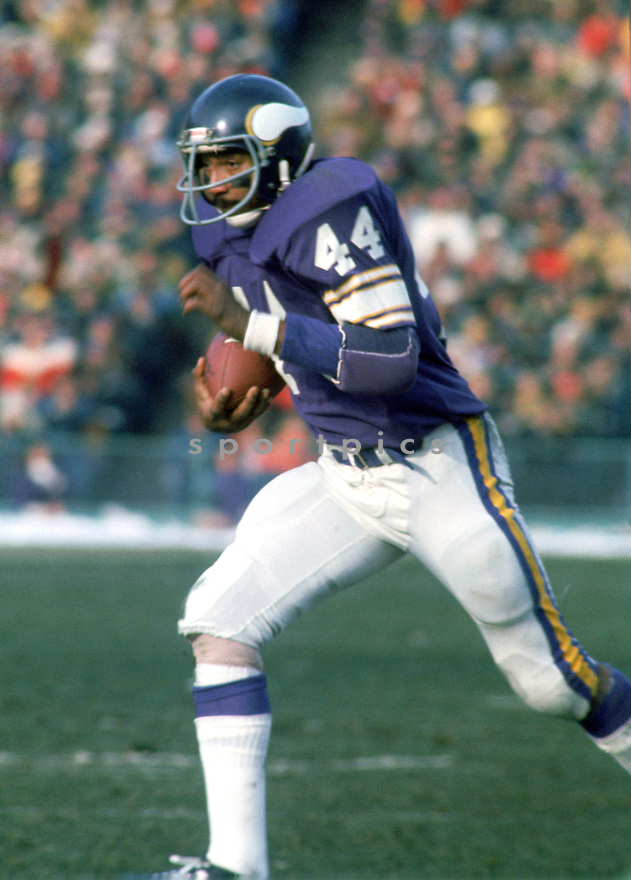 Minnesota Vikings Chuck Foreman (44) during a game from his career with the Minnesota Vikings. Chuck Foreman played 8 seasons, with 2 different team and was a 5-time Pro Bowler.(SportPics)