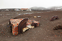 Half buried ovens are remnants of the whaling industry from the 1900's.  Located at Whalers Bay in the South Shetland Islands near the Antarctic Peninsula.