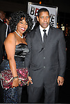 "HOLLYWOOD, CA. - January 11: Denzel Washington and wife Pauletta Washington attend the ""The Book Of Eli"" Los Angeles Premiere at Grauman's Chinese Theatre on January 11, 2010 in Hollywood, California."