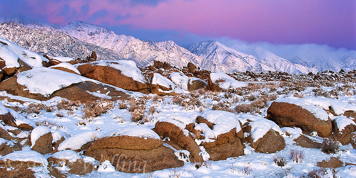902000023 panoramic view of a winter sunrise with snow covered granite boulders in the bureau of land management protected land the alabama hills in the southern section of the eastern sierras in kern county california