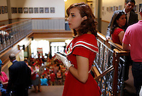 NWA Media/DAVID GOTTSCHALK - 8/19/14 - Haley Zega, of Fayetteville, left, stands on the stairwell at the Fayetteville City Administration Building August 19 , 2014 during the Fayetteville City Council  meeting. Zega was waiting to speak during the public comment section of the meeting that drew a large public turnout and response to a proposed anti-discrimination ordinance sponsored by Ward 2 Alderman MatthewPetty which would prohibit certain types ofdiscrimination based on sexualorientation and gender identity and would create a municipal civilrights administrator position.
