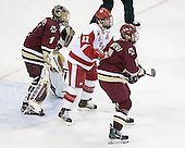 Jake Dowell 11 of the University of Wisconsin camps out between Cory Schneider 1 of Boston College and Tim Filangieri 5 of Boston College. The Boston College Eagles defeated the University of Wisconsin Badgers 3-0 on Friday, October 27, 2006, at the Kohl Center in Madison, Wisconsin in their first meeting since the 2006 Frozen Four Final which Wisconsin won 2-1 to take the national championship.<br />