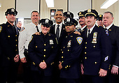 United States President Barack Obama takes a group photo with members of the NYPD at the First Precinct before visiting Ground Zero, the site of the former Twin Towers, days after Osama Bin Laden was killed by U.S. Navy Seals almost 10 years after the terrorist attacks on the World Trade Center in New York on May 5, 2011.   .Credit: John Angelillo / Pool via CNP