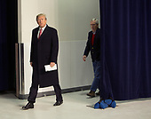 United States President Donald J. Trump, followed by US Senate Majority Leader Mitch McConnell (Republican of Kentucky) arrives to speak to the media at Camp David, the presidential retreat near Thurmont, Maryland after holding meetings with staff, members of his Cabinet and Republican members of Congress to discuss the Republican legislative agenda for 2018 on January 6, 2018.<br /> Credit: Chris Kleponis / Pool via CNP