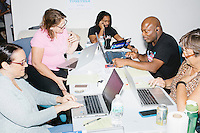 Members of the Voter Protection phonebanking team call people to recruit volunteer poll watchers at the campaign office of Democratic presidential nominee Hillary Clinton in the Wynwood Arts District of Miami, Florida.