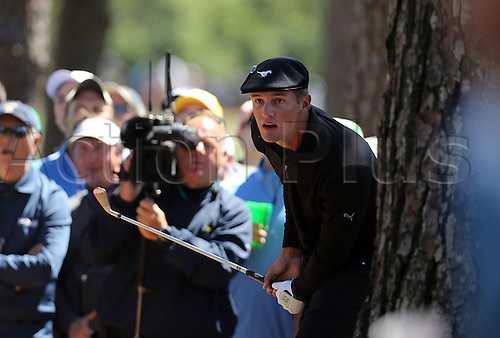 09.04.2016. Augusta, GA, USA.  Bryson DeChambeau hits from out of the woods on the 1st fairway during the third round of the 80th Masters at the Augusta National Golf Club in Augusta, Ga., on Saturday, April 9, 2016