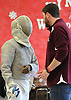 Quentin Bucknor of Garden City, left, and fencing coach Kevin Oliver have a chat during a meet against Great Neck South at Garden City High School on Saturday, Jan. 9, 2016.