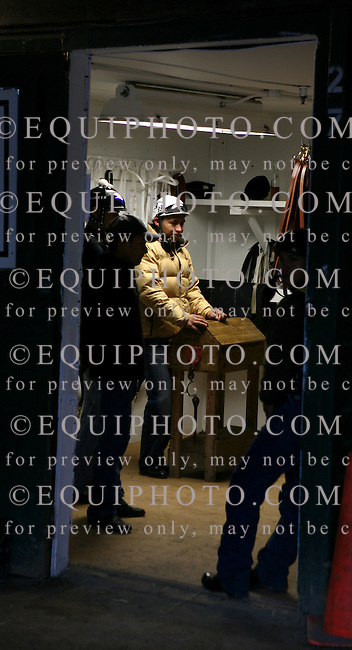 Exercise riders from the Todd Pletcher stable wait spend their break time in the tack room at Monmouth Park on October 25, 2007.  Photo By Bill Denver/EQUI-PHOTO