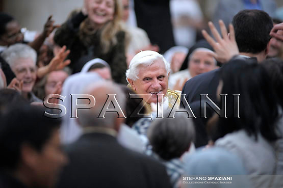 Pope Benedict XVI looks on during a mass at Saint Bartolomew Basilica on the Tiberina Island in Rome April 7, 2008