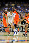 31 MAR 2012: Forward Anthony Davis (23) from the University of Kentucky hustles to control the ball in front of teammates Chris Smith (5), Gorgui Dieng (10) and Chane Behanan (24) from the University of Louisville during the Semifinal Game of the 2012 NCAA Men's Division I Basketball Championship Final Four held at the Mercedes-Benz Superdome hosted by Tulane University in New Orleans, LA. Ryan McKeee/ NCAA Photos.