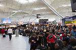 People waiting in departure lounges area at Stansted airport, Essex, England, Uk