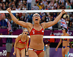 USA's Kerri Walsh Jennings and Misty May-Treanor celebrate their win over China's Chen Zue and Xi Zhang.  Walsh Jennings and May-Treanor defeated Xue and Zhangin the semi-finals of the Women Beach Volleyball at the London Olympics on Tuesday, August 7, 2012 in London, England. (AP Photo/Margaret Bowles)