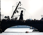With Compliments.  Shooting into the sun the Giant Granny makes a wonderful silhouette as she crosses Sarsfield Bridge on her journey as part of Limerick City of Culture where tens of thousand people turned out to view her walking and riding in her wheelchair over the weekend.<br /> Picture Liam Burke/Press 22