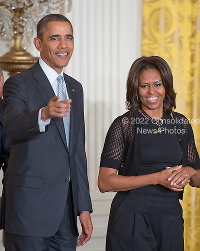 United States President Barack Obama and First Lady Michelle Obama depart after welcoming members of the United States teams and delegations from the 2014 Olympic and Paralympic Winter Games in Sochi to the White House in Washongton, D.C. on Thursday, April 3, 2014.<br /> Credit: Ron Sachs / Pool via CNP