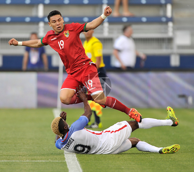 The Bolivian Men's National Team traveled to Kansas City, Kansas to play an international friendly game against the USA Men's National Team on Saturday May 28, 2016. The game was a warmup for both teams as they prepare for the upcoming Copa America. Bolivia forward Carmelo Algaranaz (19) leaps over United States forward Gyasi Zardes (9) as the ball goes out of bounds and they both had tried to save it.