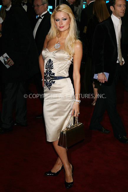 Paris Hilton attends the Casino Royale world premiere, at Odeon West End, London - 14 November 2006..FAMOUS PICTURES AND FEATURES AGENCY 13 HARWOOD ROAD LONDON SW6 4QP UNITED KINGDOM tel +44 (0) 20 7731 9333 fax +44 (0) 20 7731 9330 e-mail info@famous.uk.com www.famous.uk.com.FAM19019
