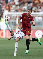Calcio, Serie A: Roma, stadio Olimpico, 28 maggio 2017.<br /> Genoa's Ezequiel Munoz (l) in action with AS Roma's Edin Dzeko during the Italian Serie A football match between AS Roma and Genoa at Rome's Olympic stadium, May 28, 2017.<br /> Francesco Totti's final match with Roma after a 25-season career with his hometown club.<br /> UPDATE IMAGES PRESS/Isabella Bonotto