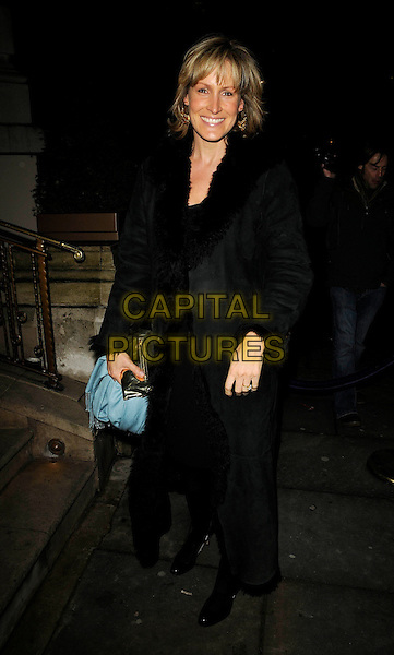 """SANTA SEBAG MONTEFIORE .Attending the book launch party for """"In Bed With..."""" at the Artesian at The Langham Hotel, Portland Place, London, England, February 11th 2009..full length Sebag-Montefiore black long maxi sheepskin fur lined coat .CAP/CAN.©Can Nguyen/Capital Pictures"""