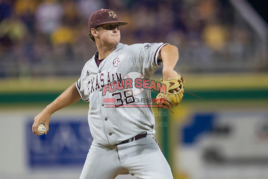 Texas A&M Aggies pitcher Grayson Long (38) makes a pickoff throw to first base during a Southeastern Conference baseball game against the LSU Tigers on April 23, 2015 at Alex Box Stadium in Baton Rouge, Louisiana. LSU defeated Texas A&M 4-3. (Andrew Woolley/Four Seam Images)