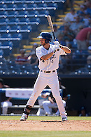 Max White (4)\ of the Asheville Tourists at bat against the Rome Braves at McCormick Field on July 26, 2015 in Asheville, North Carolina.  The Tourists defeated the Braves 16-4.  (Brian Westerholt/Four Seam Images)