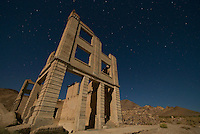 Moonlit ruins of the Cook Bank building in the ghost town of Rhyolite, Nevada, a mining boomtown that, at its peak between 1905 and 1912, had a population of 5,000 to 10,000.