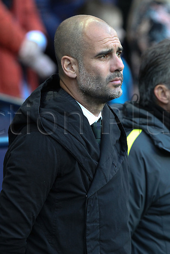 05.11.2016. Etihad Stadium, Manchester, England. Premier League Football. Manchester City versus Middlesbrough. Pep Guardiola, manager of Manchester City during the playing of the Last Post for the Remembrance Day commemoration.