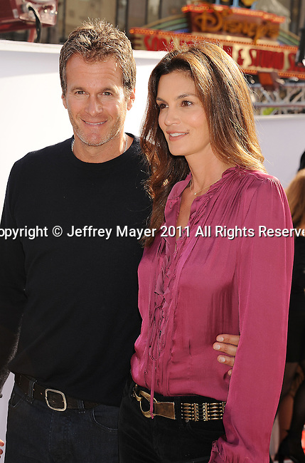 "HOLLYWOOD, CA - SEPTEMBER 25: Rande Gerber and Cindy Crawford attend Premiere Of ""Iris"" - A Journey Into The World Of Cinema By Cirque du Soleil at the Kodak Theatre on September 25, 2011 in Hollywood, California."