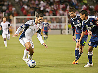 CARSON, CA – APRIL 30, 2011: New England Revolution midfielder Benny Feilhaber (22) tries to get past Chivas USA midfielder Jorge Flores (19) and defender Ante Jazic (13) during the match between Chivas USA and New England Revolution at the Home Depot Center, April 30, 2011 in Carson, California. Final score Chivas USA 3, New England Revolution 0.