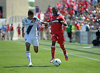 Chicago midfielder Patrick Nyarko (14) dribbles down the field while being pressured by LA Galaxy defender Sean Franklin (5).  The LA Galaxy defeated the Chicago Fire 2-0 at Toyota Park in Bridgeview, IL on July 8, 2012.