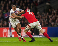 Englands' Jonathan Joseph is tackled by Wales' Cory Hill<br /> <br /> Photographer Bob Bradford/CameraSport<br /> <br /> NatWest Six Nations Championship - England v Wales - Saturday 10th February 2018 - Twickenham Stadium - London<br /> <br /> World Copyright &copy; 2018 CameraSport. All rights reserved. 43 Linden Ave. Countesthorpe. Leicester. England. LE8 5PG - Tel: +44 (0) 116 277 4147 - admin@camerasport.com - www.camerasport.com