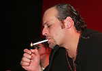 "Moenia pop music band member, Alfonso Pichardo lights a cigarrette as he talks to reporters during a press conference,in Mexico City March 28, 2006. Moenia received a golden award after selling 50 thousand copies of their last CD ""Hits Live"". Photo by © Javier Rodriguez"
