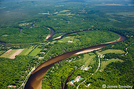 Aerial photograph view of forests and waterways throughout Northern Ontario.