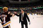 09 APR 2011: University of Minnesota Duluth coach Scott Sandelin congratulates Bulldogs forward Kyle Oleksuk (11) during the Division I Men's Ice Hockey Championship held at the Xcel Energy Center in St. Paul, MN. Minnesota-Duluth beat Michigan in overtime, 3-2 to claim the national title. Vince Muzik/ NCAA Photos