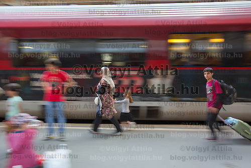 Illegal migrant family rushes to reach their train to travel to Germany at the main railway station Keleti in Budapest, Hungary on August 31, 2015. ATTILA VOLGYI
