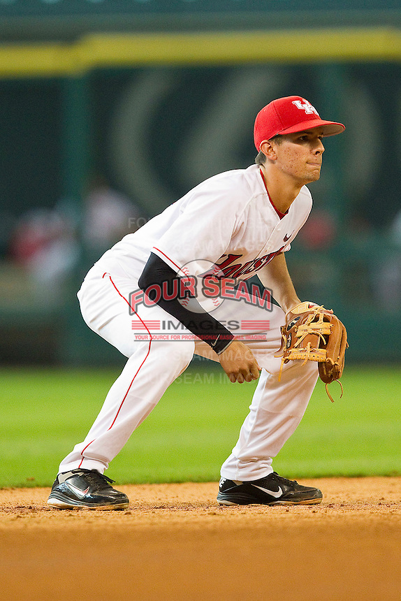 Houston Cougars shortstop Jake Runte #13 on defense against the Tennessee Volunteers at Minute Maid Park on March 2, 2012 in Houston, Texas.  The Cougars defeated the Volunteers 7-4.  (Brian Westerholt/Four Seam Images)