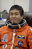 Cape Canaveral, FL - January 21, 2009 -- At NASA's Kennedy Space Center in Florida, STS-119 Mission Specialist Koichi Wakata is donning his launch-and-entry suit before heading to Launch Pad 39A for a simulated launch countdown. The astronauts are at Kennedy to prepare for launch through Terminal Countdown Demonstration Test activities. The TCDT includes equipment familiarization and emergency egress training. The crew is targeted to launch on the STS-119 mission Feb. 12 on space shuttle Discovery. During the 14-day mission, the crew will install the S6 truss segment and solar arrays to the starboard side of the International Space Station, completing the station's truss, or backbone..Credit: Kim Shiflett - NASA via CNP