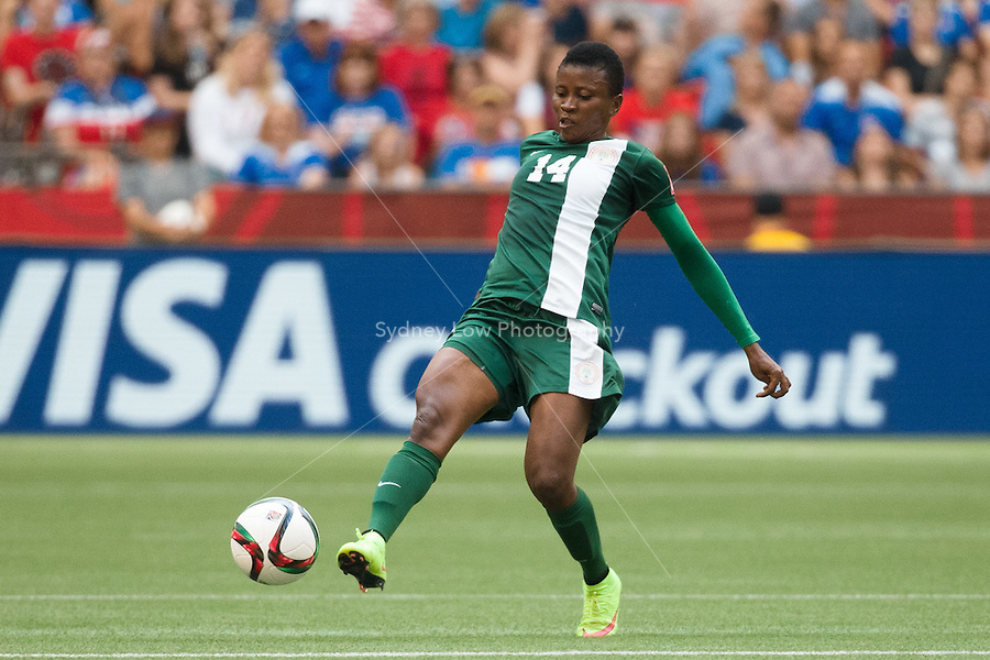 June 16, 2015: Evelyn NWABUOKU of Nigeria kicks the ball during a Group D match at the FIFA Women's World Cup Canada 2015 between Nigeria and the USA at BC Place Stadium on 16 June 2015 in Vancouver, Canada. USA won 1-0. Sydney Low/Asteriskimages.com