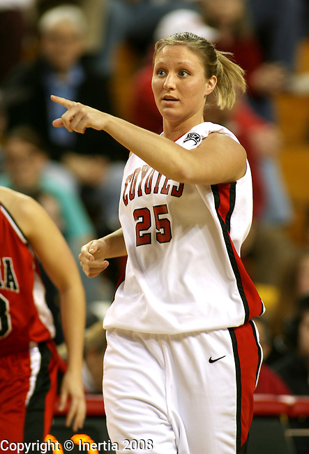 VERMILLION, SD - JANUARY 24:  Natalie Carda #25 of the University of South Dakota directs teammates upon entering the game against Nebraska-Omaha in the second half Thursday night at the DakotaDome in Vermillion. Carda has recently been diagnosed with Multiple Sclerosis. (Photo by Dave Eggen/Inertia)