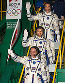 Expedition 38 Soyuz Commander Mikhail Tyurin of Roscosmos, holding the Olympic torch, Flight Engineer Koichi Wakata of the Japan Aerospace Exploration Agency, and, Flight Engineer Rick Mastracchio of NASA top, wave farewell prior to boarding the Soyuz TMA-11M rocket for launch, Thursday, Nov. 7, 2013, at the Baikonur Cosmodrome in Kazakhstan.  The Olympic torch have a four-day visit to the International Space Station.  Tyurin, Mastracchio, and, Wakata will spend the next six months aboard the International Space Station.  <br /> Mandatory Credit: Bill Ingalls / NASA via CNP