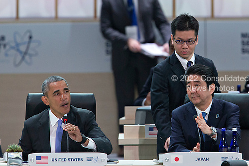 """United States President Barack Obama, left, speaks as Shinzo Abe, Japan's prime minister, right, listens during an opening plenary entitled """"National Actions to Enhance Nuclear Security"""" at the Nuclear Security Summit in Washington, D.C., U.S., on Friday, April 1, 2016. After a spate of terrorist attacks from Europe to Africa, Obama is rallying international support during the summit for an effort to keep Islamic State and similar groups from obtaining nuclear material and other weapons of mass destruction. <br /> Credit: Andrew Harrer / Pool via CNP"""