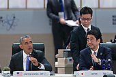 "United States President Barack Obama, left, speaks as Shinzo Abe, Japan's prime minister, right, listens during an opening plenary entitled ""National Actions to Enhance Nuclear Security"" at the Nuclear Security Summit in Washington, D.C., U.S., on Friday, April 1, 2016. After a spate of terrorist attacks from Europe to Africa, Obama is rallying international support during the summit for an effort to keep Islamic State and similar groups from obtaining nuclear material and other weapons of mass destruction. <br /> Credit: Andrew Harrer / Pool via CNP"