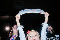 A girl holds a campaign sign as Vermont senator and Democratic presidential candidate Bernie Sanders speaks at a town hall at the Rochester Opera House in Rochester, New Hampshire, on Thurs., Feb. 4, 2016. Press and attendee turnout was low for the event because of scheduling issues. The rally had been scheduled for the previous day, postponed, and then rescheduled just a few hours before the event took place. Later that night, Sanders took part in an MSNBC-sponsored debate with Hillary Rodham Clinton.