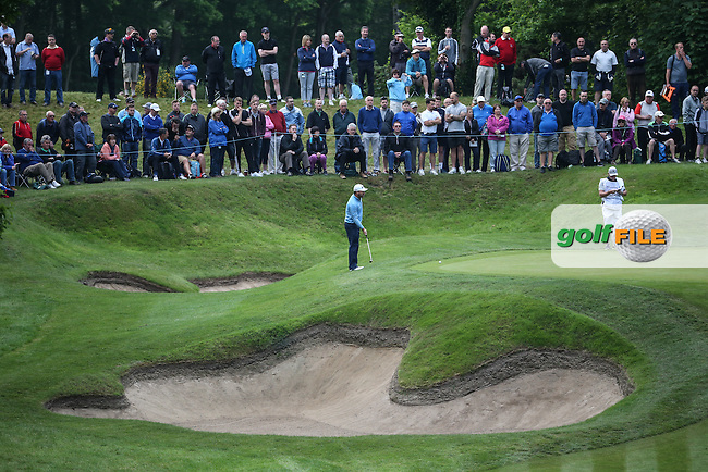 Graeme McDowell (NIR) circumnavigates the 2nd green during Round Two of the 2016 BMW PGA Championship over the West Course at Wentworth, Virginia Water, London. 27/05/2016. Picture: Golffile   David Lloyd. <br /> <br /> All photo usage must display a mandatory copyright credit to &copy; Golffile   David Lloyd.