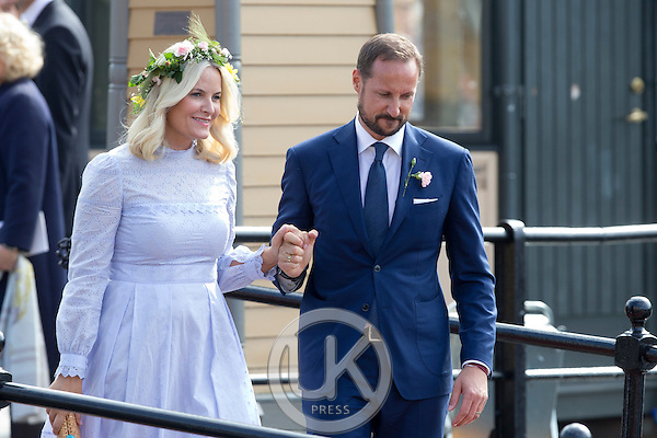 TRONDHEIM, NORWAY - JUNE 23:  Crown Princess Mette-Marit, and Crown Prince Haakon of Norway depart for the Norwegian Royal Yacht, KS Norge, after a day of events in  Trondheim, during the King and Queen of Norway's Silver Jubilee Tour, on June 23, 2016 in Trondheim, Norway.